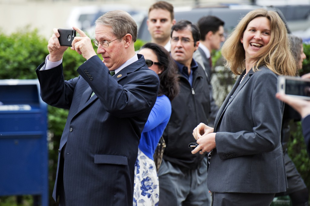 Rep. Robert W. Goodlatte, R-Va., takes a picture outside of the RNC. (Tom Williams/CQ Roll Call)