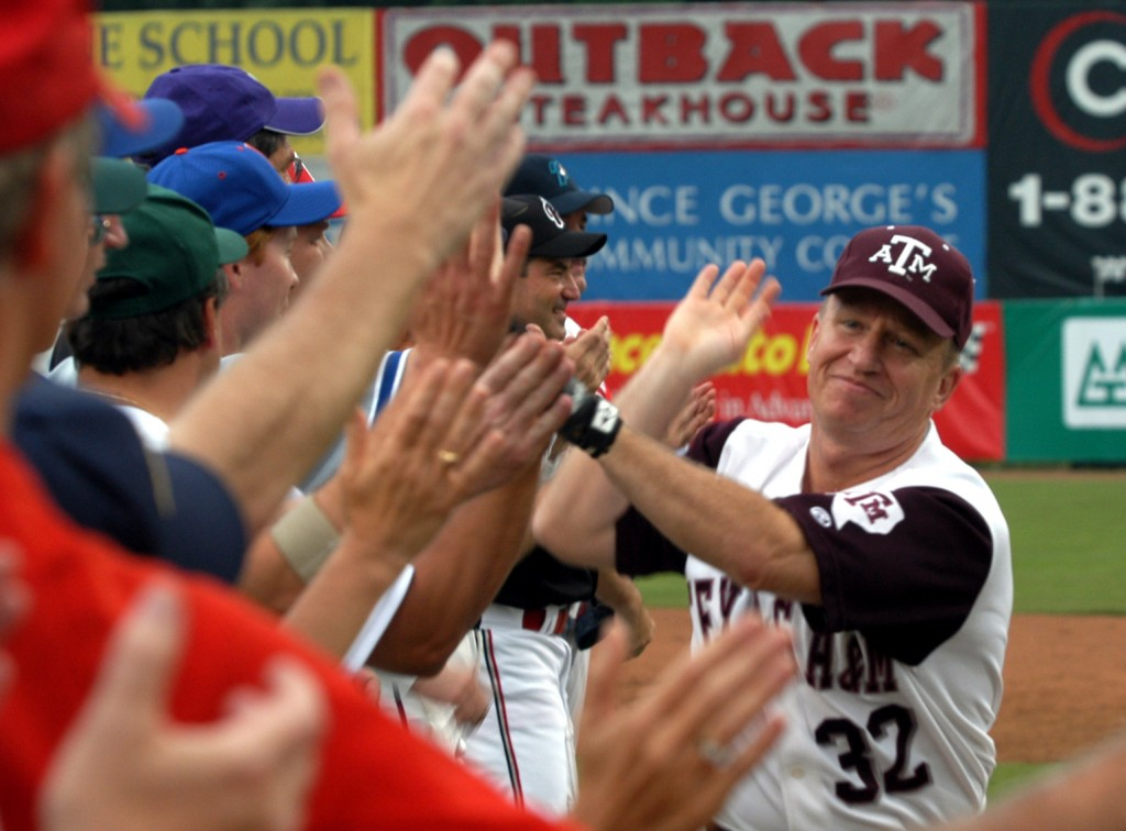 Texas Rep. Kevin Brady greets teammates at the start of the Congressional Baseball Game in 2003. (CQ Roll Call file photo)