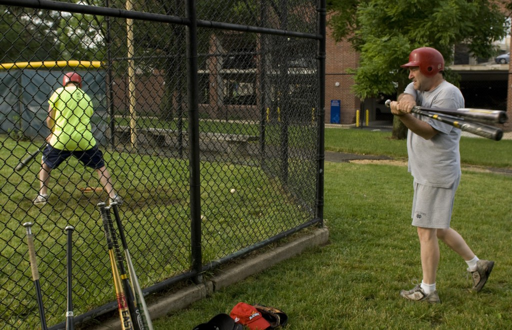Colorado Rep. Ed Perlmutter takes batting practice as Rep. Joe Donnelly (now Indiana's junior senator) waits his turn during the Democrats' practice in 2008. (CQ Roll Call file photo)