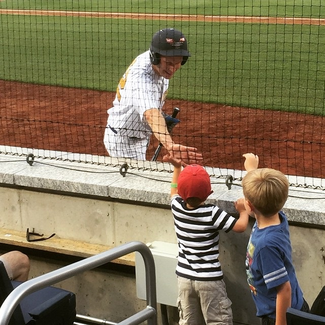 Connecticut Sen. Christopher S. Murphy greets his children at the 2015 Congressional Baseball Game. (Courtesy Sen. Christopher S. Murphy)