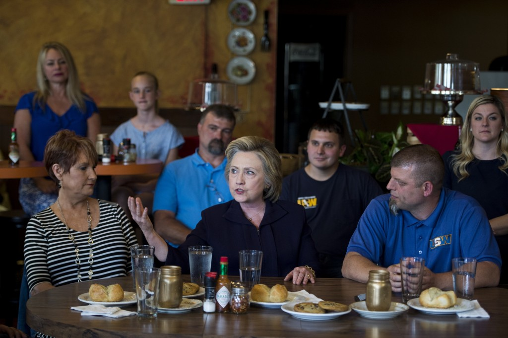 Presidential candidate Hillary Clinton speaks with local steel workers and civic leaders during her campaign stop at Alma's Italian Cafe in Ashland, Ky. (Bill Clark/CQ Roll Call)
