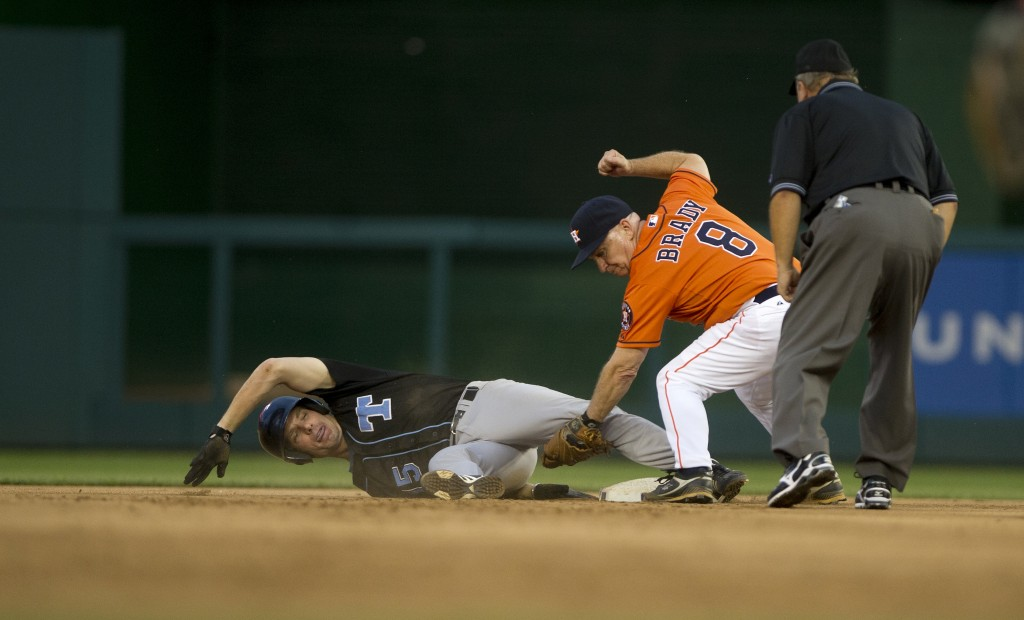 Rep. John Carney is safe at 2nd as Rep. Kevin Brady applies the tag at the 52nd annual Congressional Baseball Game in 2013. (Photo By Douglas Graham/CQ Roll Call File Photo)