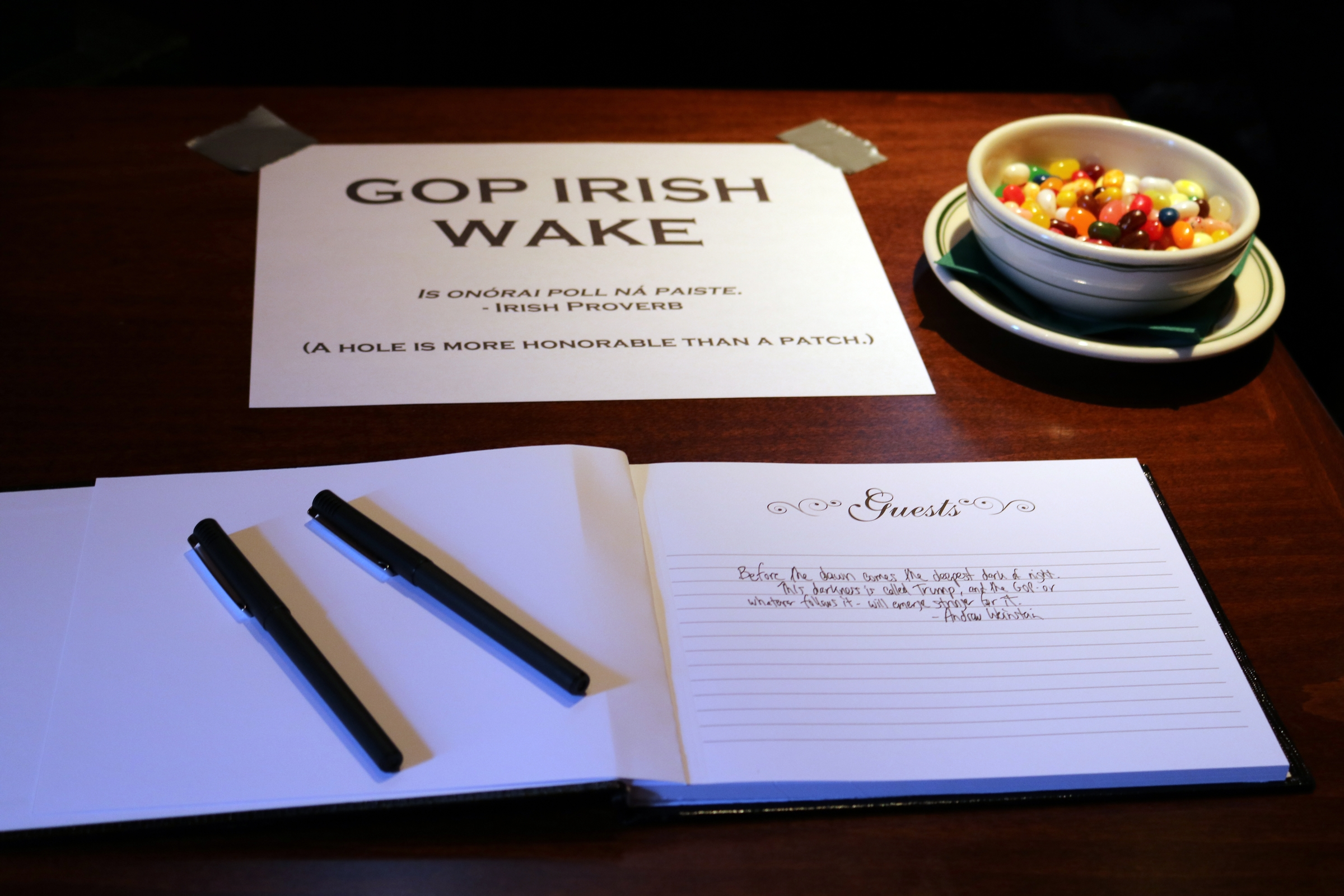 The traditional Irish wake for the Republican Party, held in the back bar of The Dubliner, offered attendees a guest book to sign and offer condolences. Former Republican staffer Andrew Weinstein organized the wake as a counter to Donald Trump's presidential acceptance speech.