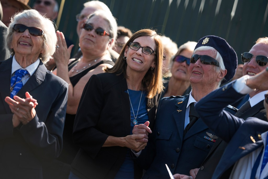 Arizona Rep. Martha McSally, center, and former WASP Shutsy Reynolds, 93, right, watch a flyover before Harmon's services. (Tom Williams/CQ Roll Call)