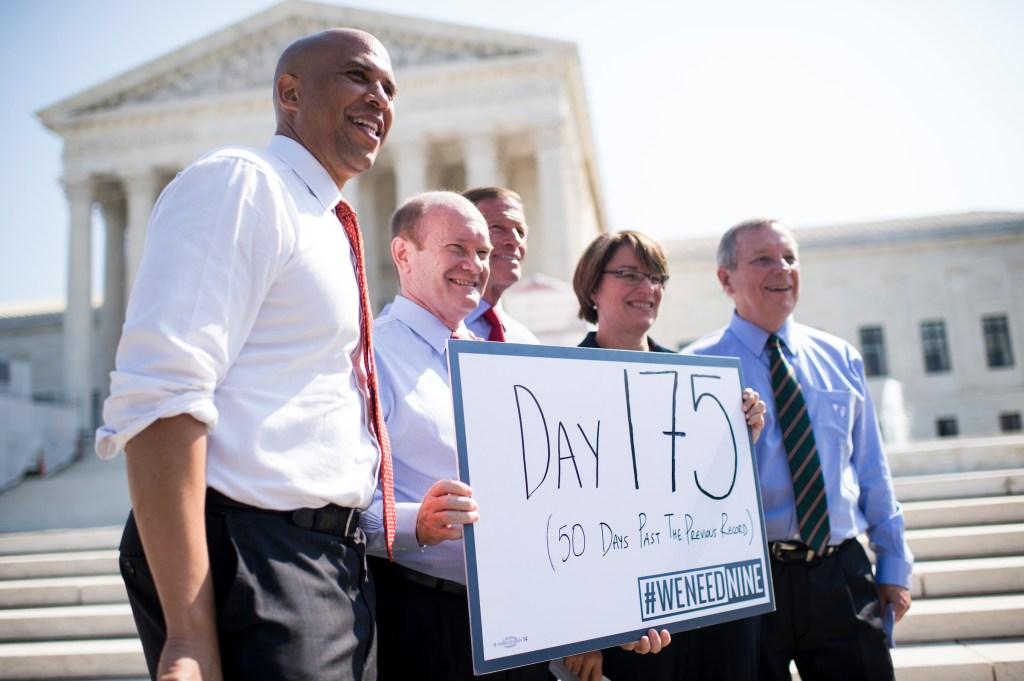 From left, Sen. Cory Booker, D-N.J., Sen. Chris Coons, D-Del., Sen. Richard Blumenthal, D-Conn., Sen. Amy Klobuchar, D-Minn., and Sen. Richard Durbin, D-Ill., hold a sign which reads