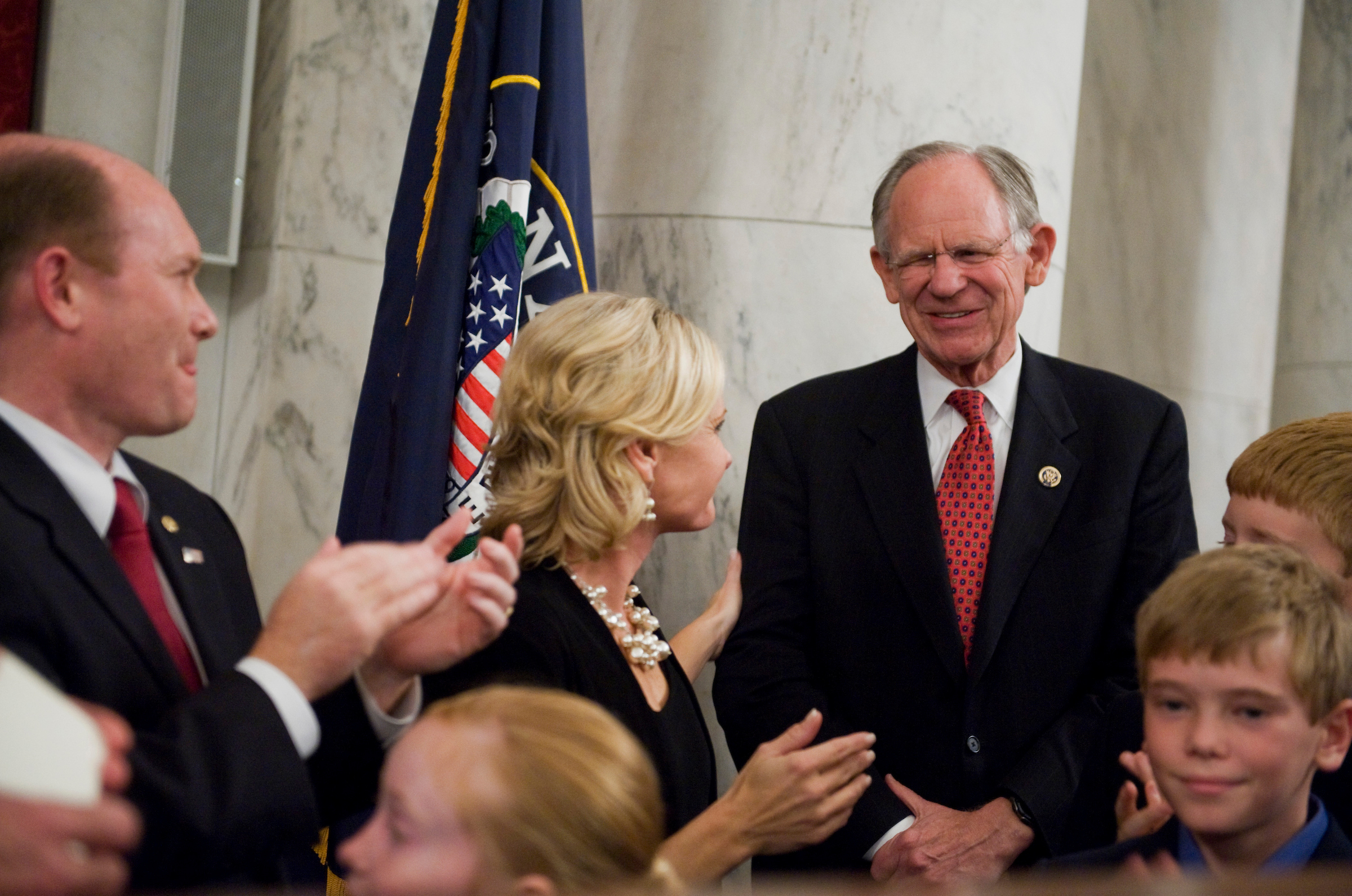 UNITED STATES - NOVEMBER 15: Rep, Mike Castle, R-Del., is recognized by Sen. Chris Coons, D-Del., and his wife Annie at reception in Coons' honor in Russell Building. (Photo By Tom Williams/Roll Call)