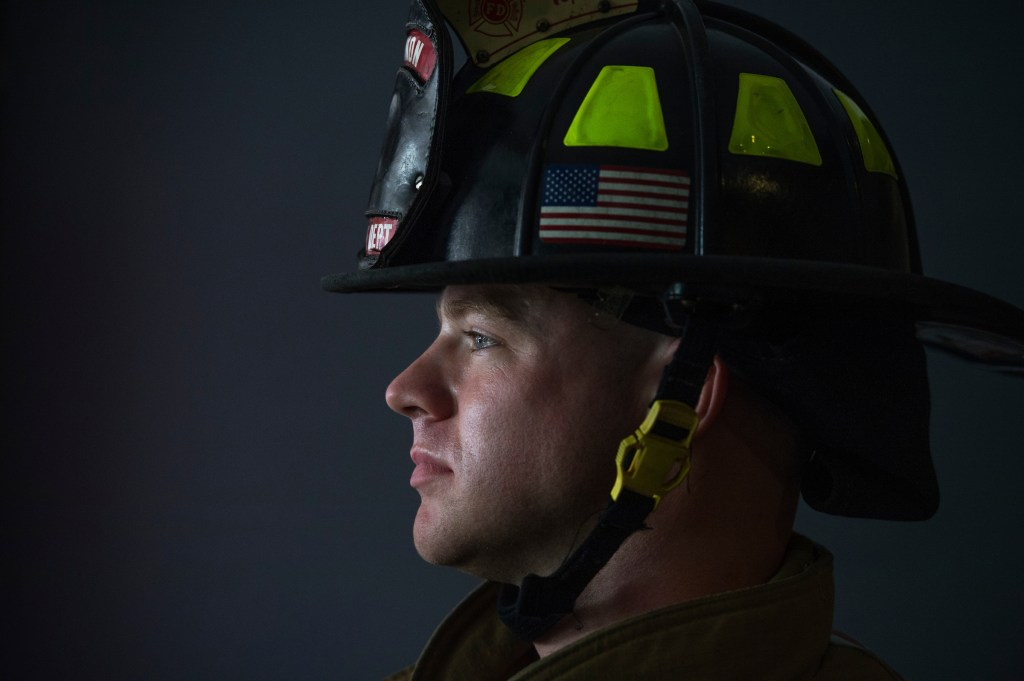 A firefighter prepares for the 9/11 Memorial Stair Climb in the Brady Sullivan Building in Manchester, N.H., on Sunday, Sept. 11, 2016. Participants climb the stairs of the 20 story building five times in honor of the firefighters killed in the World Trade Center. The event benefits the National Fallen Firefighters Foundation. New Hampshire Sen. Kelly Ayotte attended the event. (Tom Williams/CQ Roll Call)