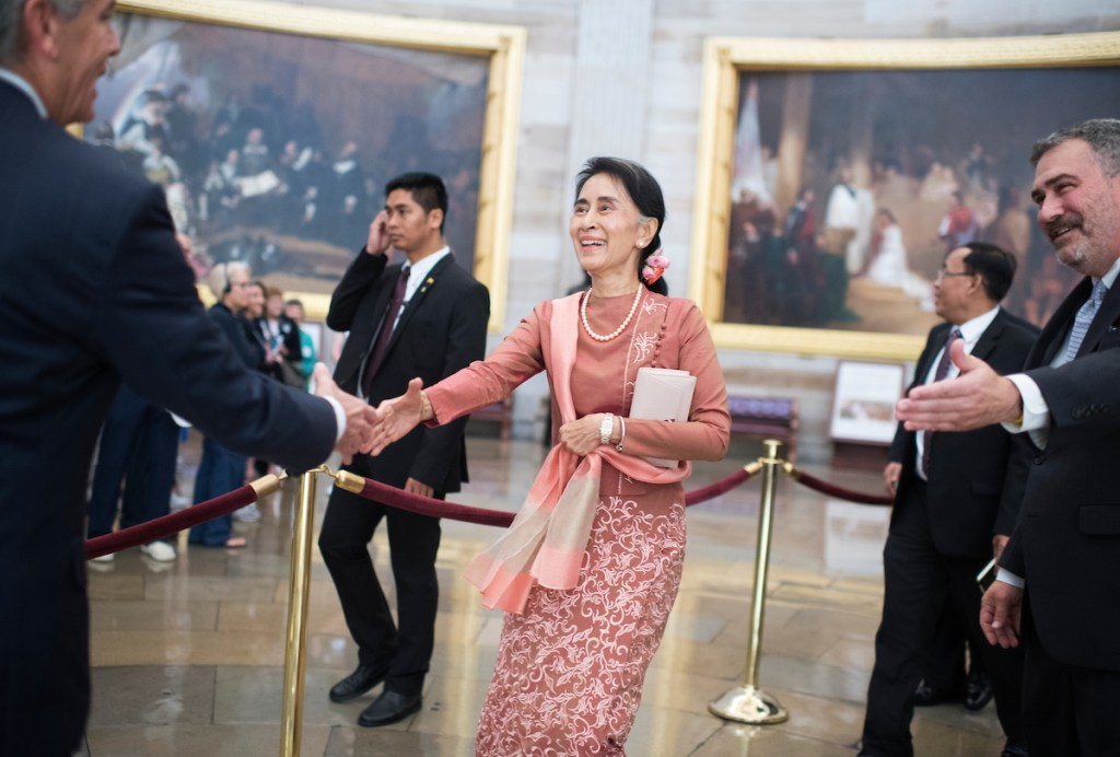 Aung San Suu Kyi, center, state counselor and foreign minister of Myanmar, greets Frank Larkin, left, Senate sergeant-at-arms, in the Capitol Rotunda between meetings with House Minority Leader Nancy Pelosi and Senate leaders, on Thursday, Sept. 15, 2016. Ted Daniel, of the House sergeant-at-arms, appears at right. (Tom Williams/CQ Roll Call)