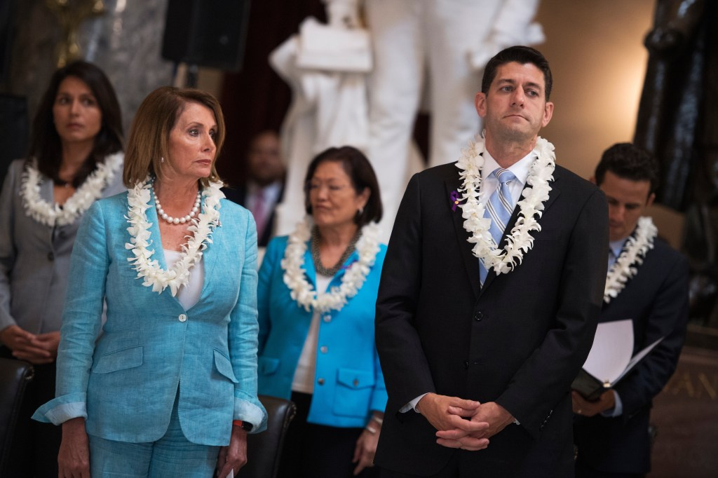 From left, Hawaii Rep. Tulsi Gabbard, House Minority Leader Nancy Pelosi, Hawaii Sen. Mazie Hirono, House Speaker Paul Ryan and Hawaii Sen. Brian Schatz attend a memorial service for the late Hawaii Rep. Mark Takai, in the Capitol's Statuary Hall on Wednesday, Sept. 14, 2016. (Tom Williams/CQ Roll Call)