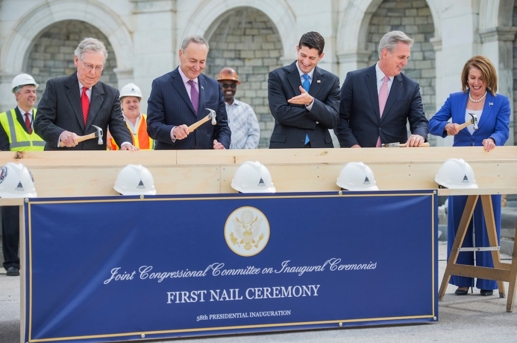 From left, Senate Majority Leader Mitch McConnell, New York Sen. Charles E. Schumer, House Speaker Paul D. Ryan, House Majority Leader Kevin McCarthy and House Minority Leader Nancy Pelosi participate in the First Nail ceremony that launches the construction of the Inaugural platform on the West Front of the Capitol, on Wednesday, Sept. 21. (Tom Williams/CQ Roll Call)