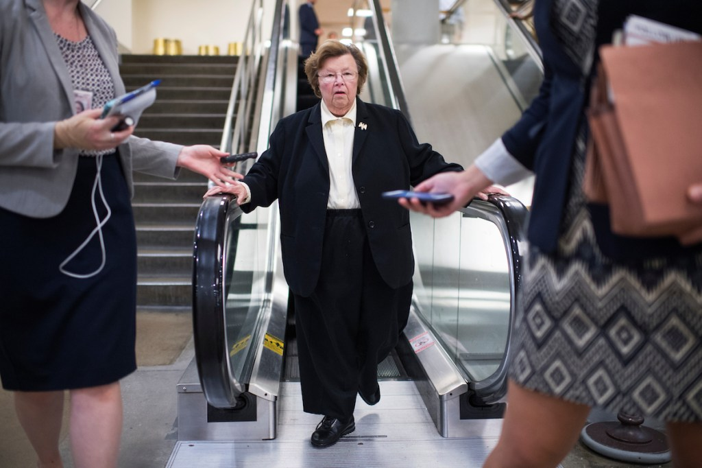 Maryland Sen. Barbara A. Mikulski talks with reporters in the Senate subway on Thursday, Sept. 22. (Tom Williams/CQ Roll Call)