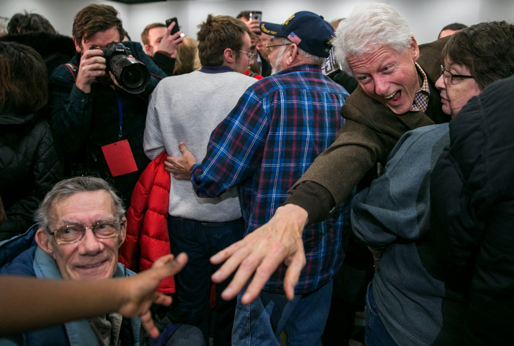 Jan. 15, 2016: Former President Bill Clinton reaches for the hand of a young boy who called out to him after a campaign event for Democratic presidential candidate Hillary Clinton, in Marshalltown, Iowa. (Al Drago/CQ Roll Call file photo)