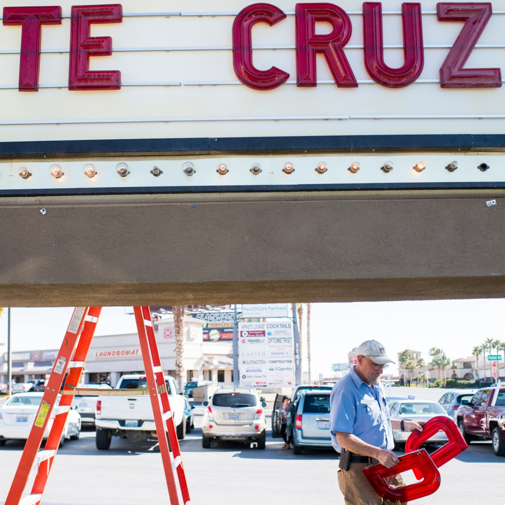 "Feb. 21, 2016: T.J. Vanderford of the Pahrump Best Western maintenance, carries ""D's to the hotel's sign at the site of the campaign rally for Cruz in Pahrump, Nev., ahead of the state's GOP caucus. The sign read ""TE CRUZ"" until they could find a ""D"" back in the office. (Bill Clark/CQ Roll Call file photo)"