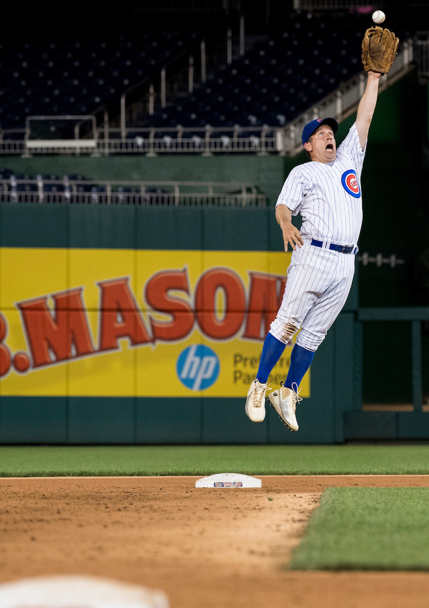 10. June 23: GOP second baseman Illinois Rep. Robert J. Dold leaps for a high throw during the Congressional Baseball Game at Nationals Park in Washington. (Bill Clark/CQ Roll Call file photo)