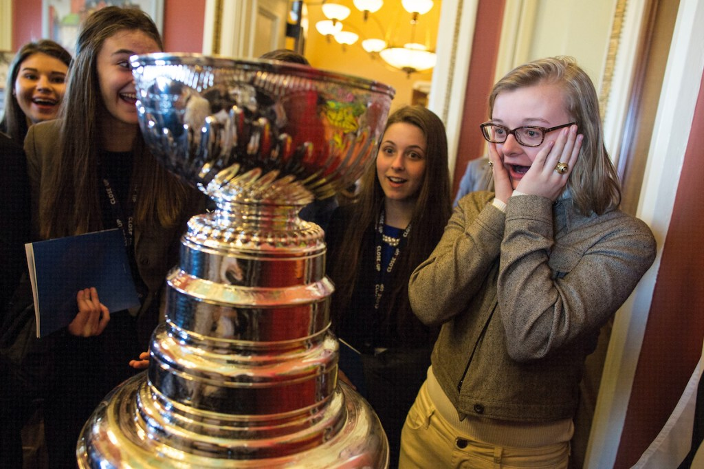 7. March 2: Rose Harper, a student from Downers Grove North High School in Downers Grove, Ill., right, stands in disbelief as she sees the Stanley Cup up close alongside her friend, Audrey McDaniel, second from right, in the office of Illinois Sen. <a class=