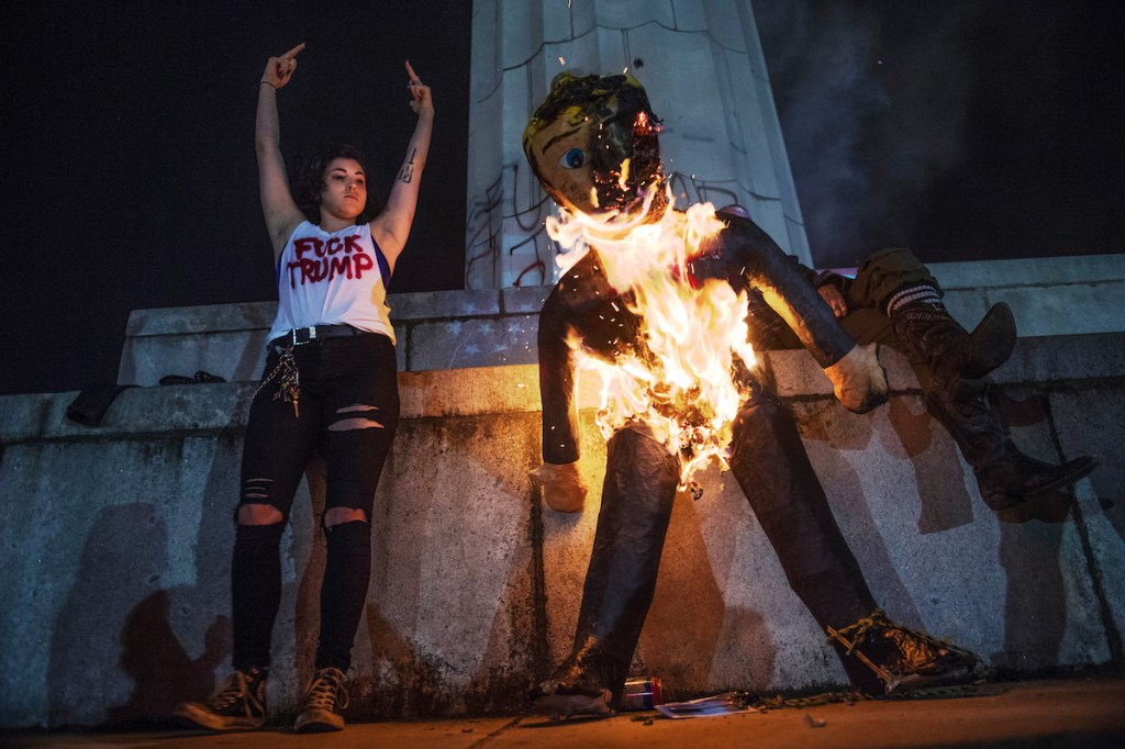 27. Nov. 9: Protesters burn an effigy of Donald Trump in Lee Circle before a march through New Orleans. (Tom Williams/CQ Roll Call file photo)