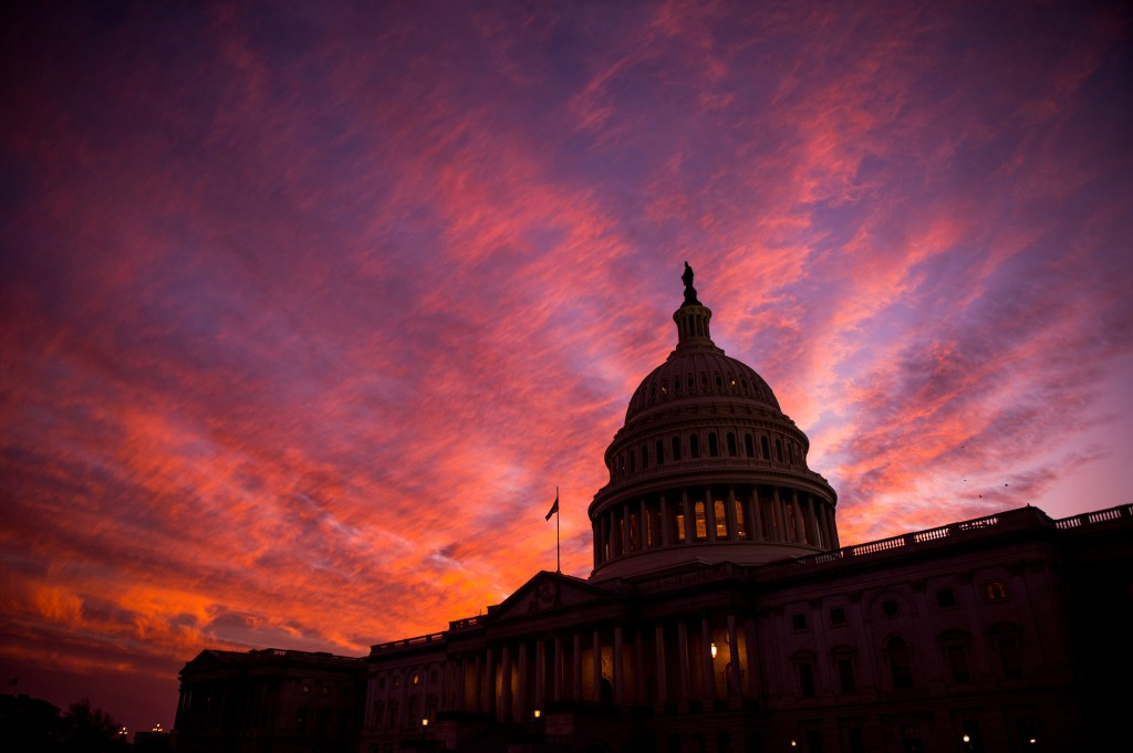 The sun sets at the U.S. Capitol as the 114th session of Congress comes to a close on Thursday, Dec. 8, 2016. The House passed spending bill to fund the government through April before heading home for the holiday recess. (Photo By Bill Clark/CQ Roll Call)