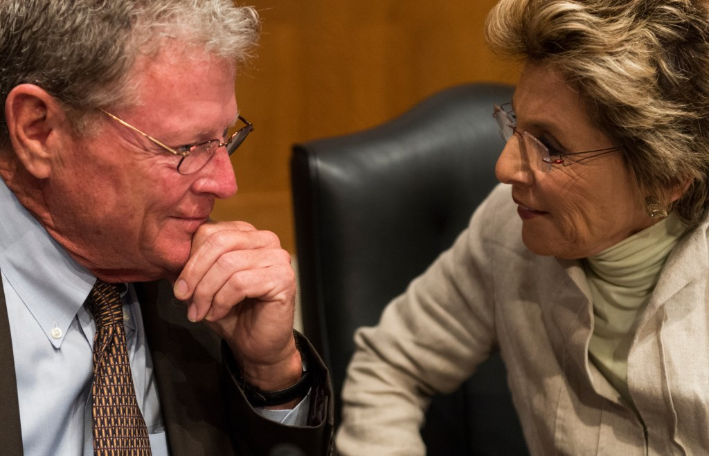 Inhofe and Boxer talk before the start of a hearing in 2012. (Bill Clark/CQ Roll Call file photo)