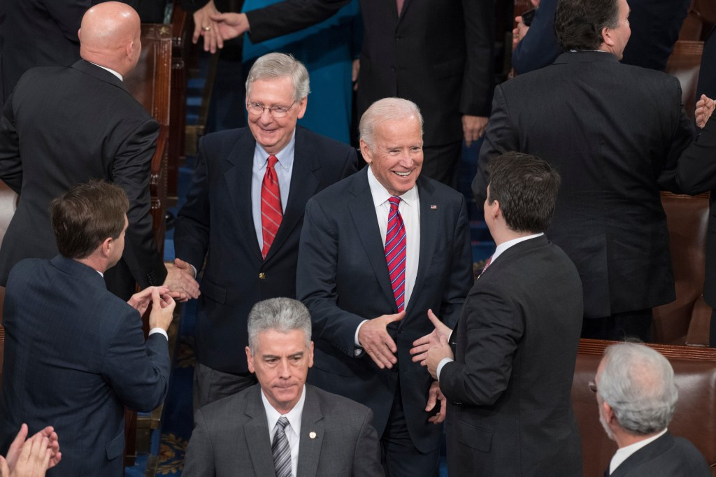 Biden and Senate Majority Leader Mitch McConnell arrive in the House chamber for a joint session of Congress to tally the Electoral College votes for president and vice president on Friday. (Tom Williams/CQ Roll Call)