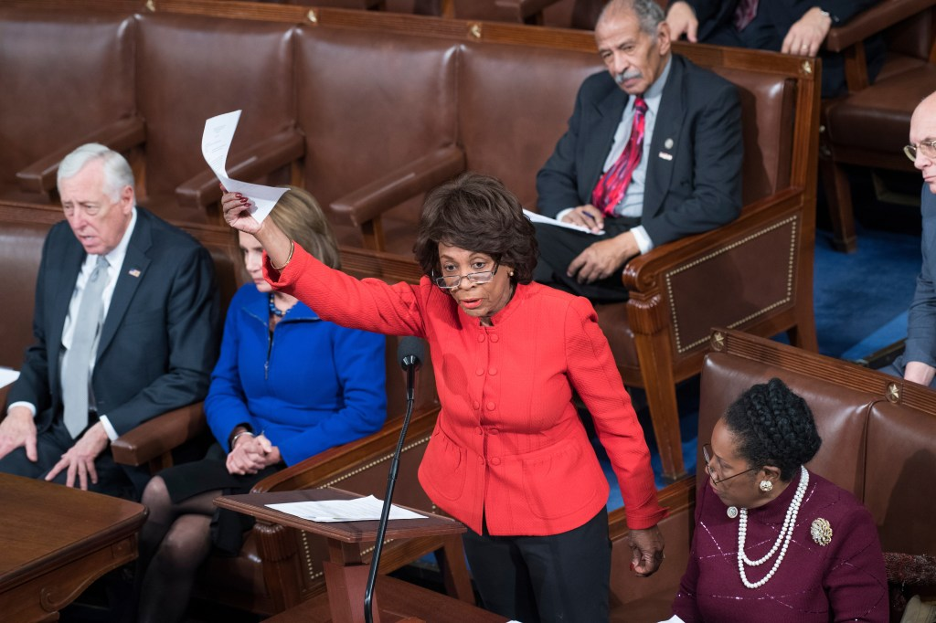 California Rep. Maxine Waters objects to the Electoral College count during a joint session of Congress to tally the electoral ballots for president and vice president on Friday. (Tom Williams/CQ Roll Call)