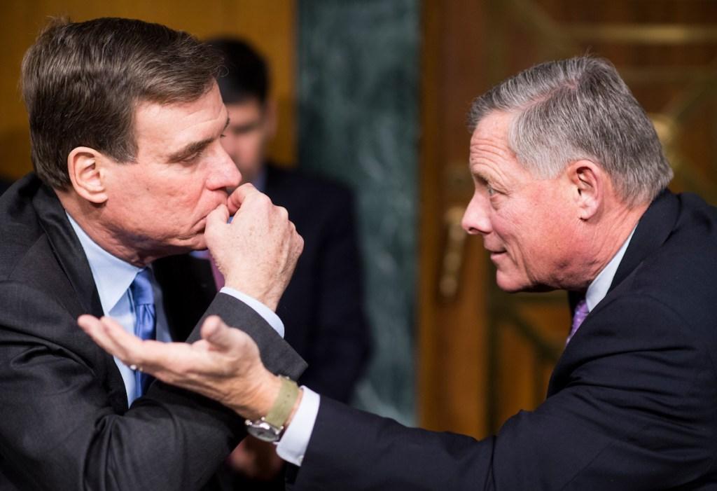 Sen. Mark Warner, D-Va., and Chairman Sen. Richard Burr, R-N.C., confer before the start of the Senate (Select) Intelligence Committee hearing on