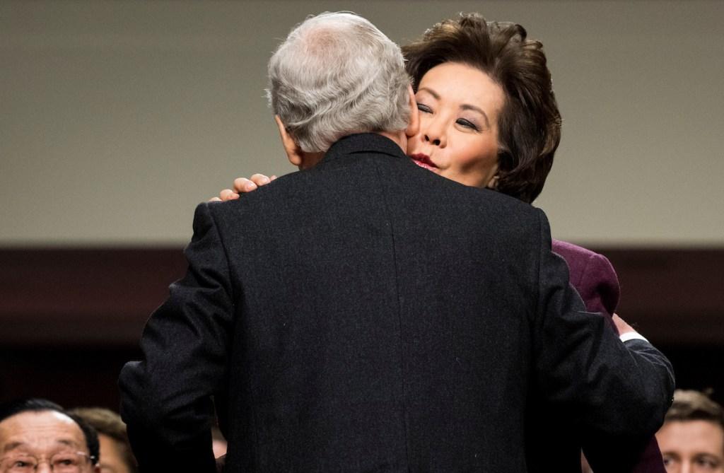 Secretary of Transportation nominee Elaine Chao gives her husband Senate Majority Leader Mitch McConnell, R-Ky., a kiss after introducing her during her Senate Commerce, Science and Transportation Committee confirmation hearing on Wednesday. (Bill Clark/CQ Roll Call)
