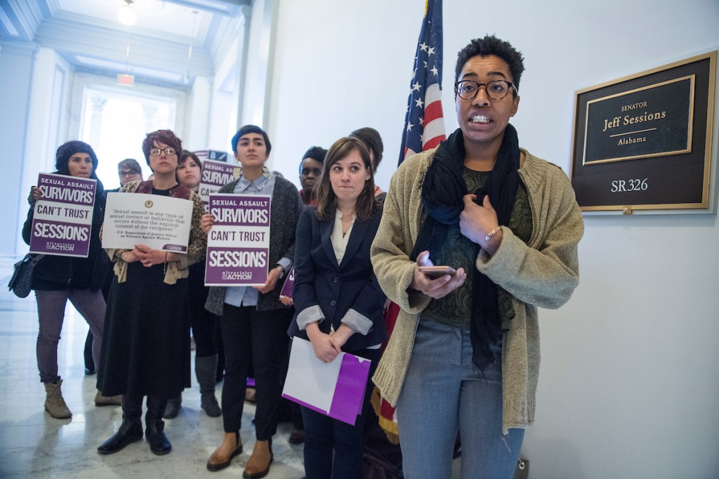 Natalie Green, a sexual assault survivor from D.C., speaks outside the Russell Building office Sessions before delivering a poster containing the Justice Department's definition of sexual assault on Monday. The women's advocacy group UltraViolet organized the delivery to Sessions because he did not acknowledge that Trump's statements about touching women constituted sexual assault. (Tom Williams/CQ Roll Call)