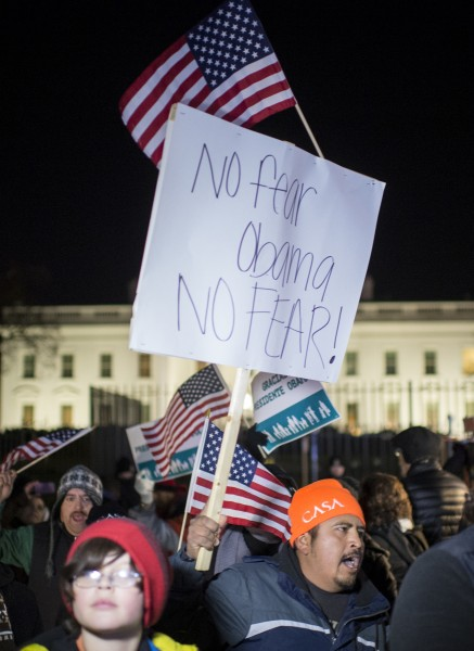 Immigration reform activists in front of the White House march and chant following President Barack Obama's speech on his executive action on immigration policies last November. (Bill Clark/CQ Roll Call File Photo)