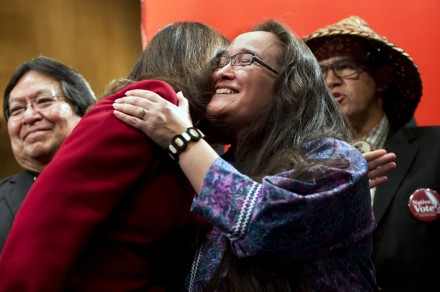 Amy Sparck Dobmeier of the Alaskan Qissunamuit Tribe, gets a hug from Cantwell. (Photo By Tom Williams/CQ Roll Call)