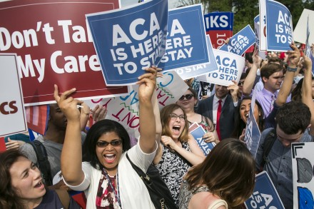 Supporters of the Affordable Care Act celebrate as the opinion for health care is reported outside of the Supreme Court. (Al Drago/CQ Roll Call)