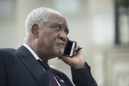 UNITED STATES - JULY 15: Rep. Danny Davis, D-Ill., talks on his cell phone on the House steps after a vote on Wednesday, July 15, 2015. (Photo By Bill Clark/CQ Roll Call)