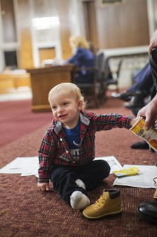 UNITED STATES - DECEMBER 15: Patrick McCabe, 1, grandson of Lisa S. Disbrow, nominee to be Under Secretary of the Air Force, plays in the Senate Armed Services Committee in Dirksen Building as Drisbow testifies during a nomination hearing, December 15, 2015. (Photo By Tom Williams/CQ Roll Call)
