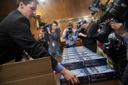 Eric Chalmers of the Senate Budget Committee unpacks copies of President Obama's budget for fiscal year 2016 Feb. 2. (Tom Williams/CQ Roll Call)