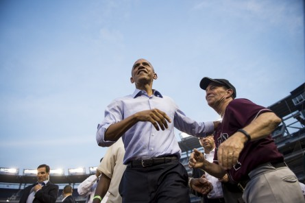 UNITED STATES - JUNE 11: President Barack Obama gets a hug from Rep. Ed Perlmutter, D-Colo., he makes a surprise visit to the Democrats' dugout during the 54th Annual Roll Call Congressional Baseball Game at Nationals Park in Washington on Thursday, June 11, 2015. The Democrats beat the Republicans 5-2. (Photo By Bill Clark/CQ Roll Call)