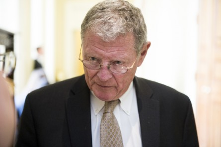 Sen. Jim Inhofe, R-Okla., speaks with a reporter as he arrives for the Senate Republicans' policy lunch on Tuesday, March 24, 2015. (Photo By Bill Clark/CQ Roll Call)