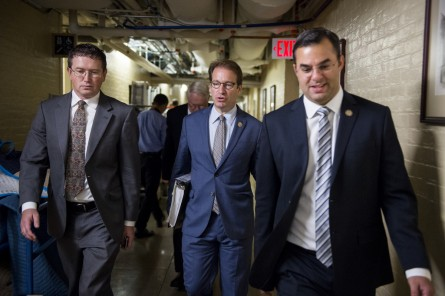 UNITED STATES - SEPTEMBER 29: From left, Rep. Thomas Massie, R-Ky., Rep. Pete Roskam, R-Ill., and Rep. Justin Amash, R-Mich., leave the House Republican Conference meeting in the basement of the U.S. Capitol on Tuesday, Sept. 29, 2015. Photo By Bill Clark/CQ Roll Call)