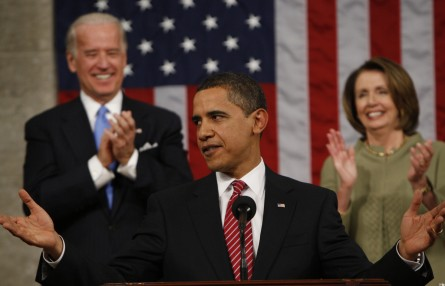 President Barack Obama acknowledegs applause before his address to a joint session of Congress in the House Chamber of the Capitol in Washington , Tuesday, Feb. 24, 2009. Vice President Biden and House Speaker Nancy Pelosi applaud at rear.  (AP Photo/Pool, Pablo Martinez Monsivais)....................