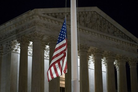 A flag at the U.S. Supreme Court is lowered to half staff following the announcement of the death of Supreme Court Justice Antonin Scalia. (Photo by BRENDAN SMIALOWSKI/AFP/Getty Images)