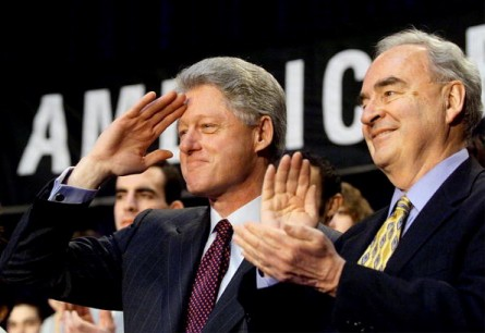 WASHINGTON, :  US President Bill Clinton (L) salutes along side Americorp CEO Harris Wofford (R) during the first national recruitment effort for Americorp volunteers at the University of Maryland's Ritchie Coliseum in College Park, Maryland 10 February. Clinton called upon Congress to expand membership and increase funding.   (ELECTRONIC IMAGE) AFP PHOTO/Stephen JAFFE (Photo credit should read STEPHEN JAFFE/AFP/Getty Images)