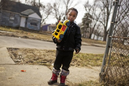 UNITED STATES - FEBRUARY 23: Davarious Griffin, 5, who has had elevated levels of lead detected in his blood, plays outside of his house on Ridgeway Avenue in Flint, Mich., February 23, 2016. The water supply was not properly treated after being switched from Lake Huron to the Flint River and now contains lead and iron. (Photo By Tom Williams/CQ Roll Call)