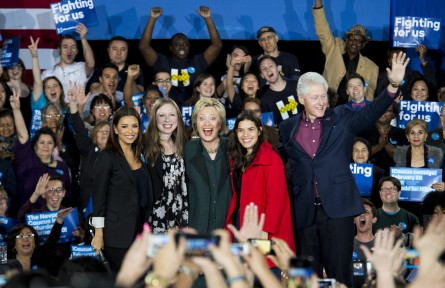 UNITED STATES - FEBRUARY 19: From left, Eva Longoria, Chelsea Clinton, Hillary Clinton, America Ferrera and Bill Clinton wave to the crowd on stage during the Hillary Clinton campaign rally at the Clark County Government Center Amphitheater in Las Vegas on Friday night, Feb. 19, 2016, one day before the Nevada Democrats' presidential caucus. (Photo By Bill Clark/CQ Roll Call)