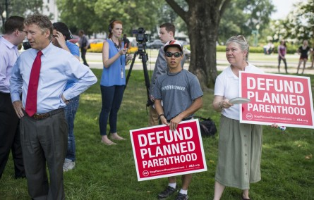 Paul waits to speak at a midday rally outside the Capitol Tuesday, in support of defunding Planned Parenthood. During the rally, Paul announced a commitment from Senate leadership for a vote on his legislation to defund Planned Parenthood prior to the August recess. (Bill Clark/CQ Roll Call)