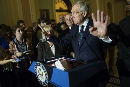 Reid answers questions Tuesday at the weekly Senate Democrat news conference. (Al Drago/CQ Roll Call)