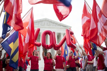 Activists celebrate the Supreme Court decision recognizing same-sex marriage in all 50 states. (Bill Clark/CQ Roll Call File Photo)
