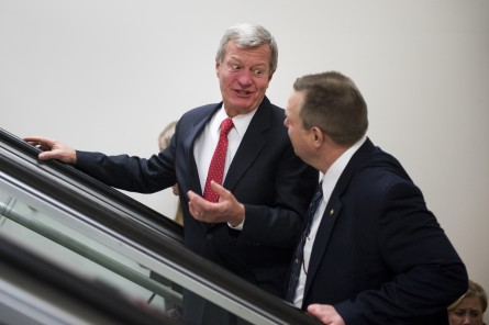 Baucus, left, is thinking about running the Beijing Marathon. (Tom Williams/CQ Roll Call File Photo.)