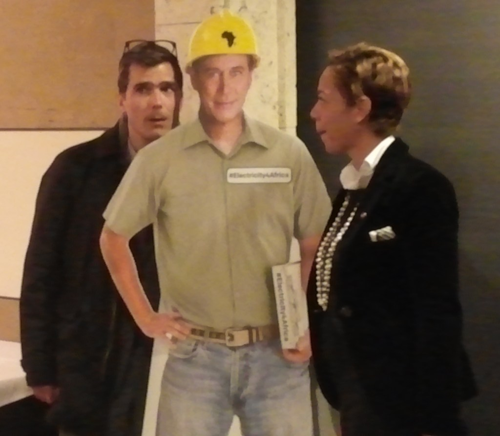 Top Chef judge Hugh Acheson and Top Chef alumna Nina Compton clown around with a cardboard cut out of House Speaker John Boehner after a ONE.org luncheon.