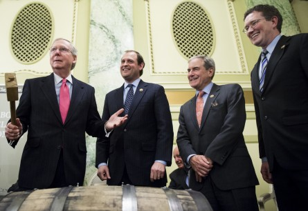 UNITED STATES - FEBRUARY 3: From left, Senate Majority Leader Mitch McConnell, R-Ky., Rep. Andy Barr, R-Ky., Rep. John Yarmuth, D-Ky., and Rep. Thomas Massie, R-Ky., prepare to bung the Bourbon Barrel of Compromise with the bung hammer at the Willard Hotel in Washington on Tuesday, Feb. 3, 2015. The Henry Clay Center for Statesmanship and the Kentucky Distillers Association joined forces to send a barrel of Kentucky Bourbon to Washington D. C. to be received by Majority Leader Mitch McConnell. (Photo By Bill Clark/CQ Roll Call)