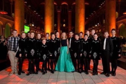 Irish step dancers pose with Irish Ambassador Anne Anderson.