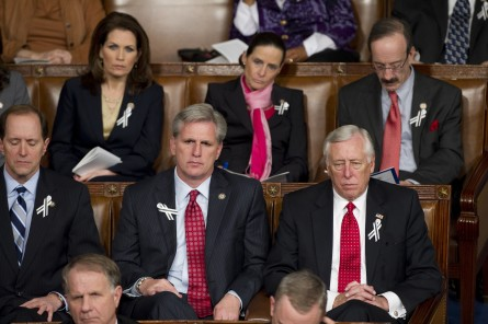 WASHINGTON, DC- Jan. 25: House Ways and Means Chairman Dave Camp, R-Mich., House Majority Whip Kevin McCarthy, R-Calif., and House Minority Whip Steny Hoyer, D-Md., and other members listen to President Barack Obama deliver his State of the Union address to a joint session of the U.S. Congress. In the wake of the Jan. 8 shootings in Tucson, Ariz., that wounded Rep. Gabrielle Giffords (D-Ariz.), there has been a push for lawmakers to break from the tradition of partisan seating at the State of Union address. In the back row are Rep. Michele Bachmann, R-Minn., Rep. Jean Schmidt, R-Ohio, and Rep. Eliot L. Engel, D-N.Y. (Photo by Scott J. Ferrell/Congressional Quarterly)