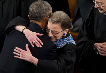 UNITED STATES - JANUARY 28: President Barack Obama hugs Supreme Court Justice Ruth Bader Ginsburg upon arriving in the House Chamber of the Capitol to deliver his State of the Union address. (Photo By Tom Williams/CQ Roll Call)